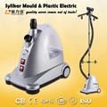 Electric garment steamer for clothing ironing with integrated fabric brush