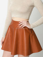 Invisible zipper and button closure leather skirt