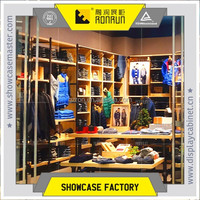 Fashion clothing store display center table and high cabinet design, wood with stainless steel
