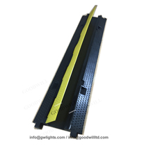 Yellow rubber floor cable protection cover