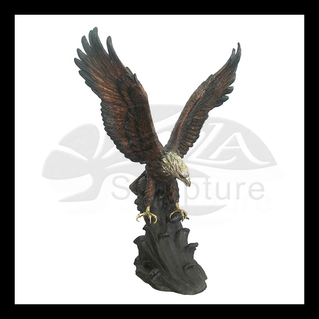 Bronze eagle standing on stone sculpture