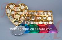 plastic chocolate candy packaging tray with gold and silver color