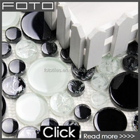 Different sized black white penny round glass mosaic tile