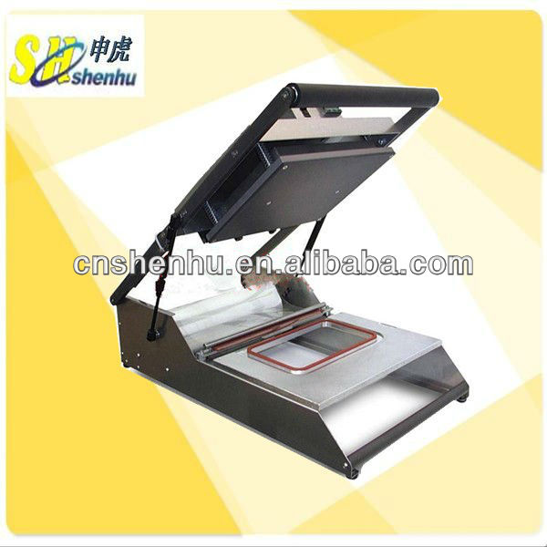 Manual tray sealer