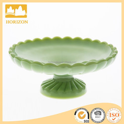 green color short stemed spiralJadite glass plate fruit and cupcake holder