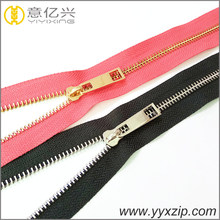 Clothing custom shiny gold and silver zipper manufacturer long chain roll metal zip