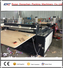 AUTOMATIC PAPER ROLL CROSS CUTTING OR SHEETING MACHINE