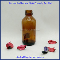 amber round glass chemical bottle