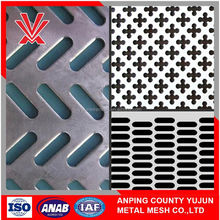Decorative perforated metal sheet for cabinets