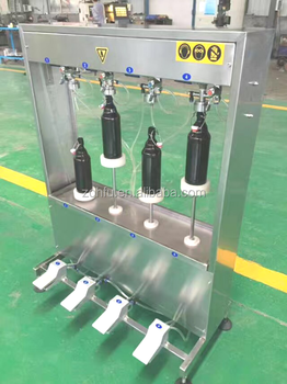 Soda water filling machine withfour filling nozzle beer filling machine