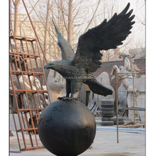 life size hot casting bronze eagle on ball statue outdoor metal sculpture