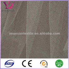 China manufacturer warp knit 100% polyester wedding dress tulle fabric roll wholesale
