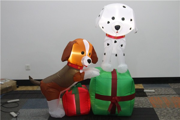 Two inflatable christmas dog stand in the gift box 2017