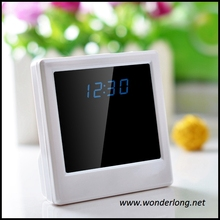Factory wholesale 720p cycle recording multi-function clock camera with motion detection