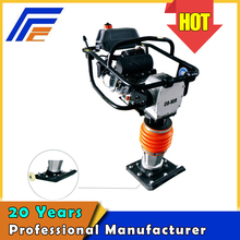 Impact vibrating tamping rammer for road machine and building construction