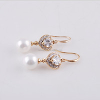 floating round shell pearl inlay heart diamond earrings