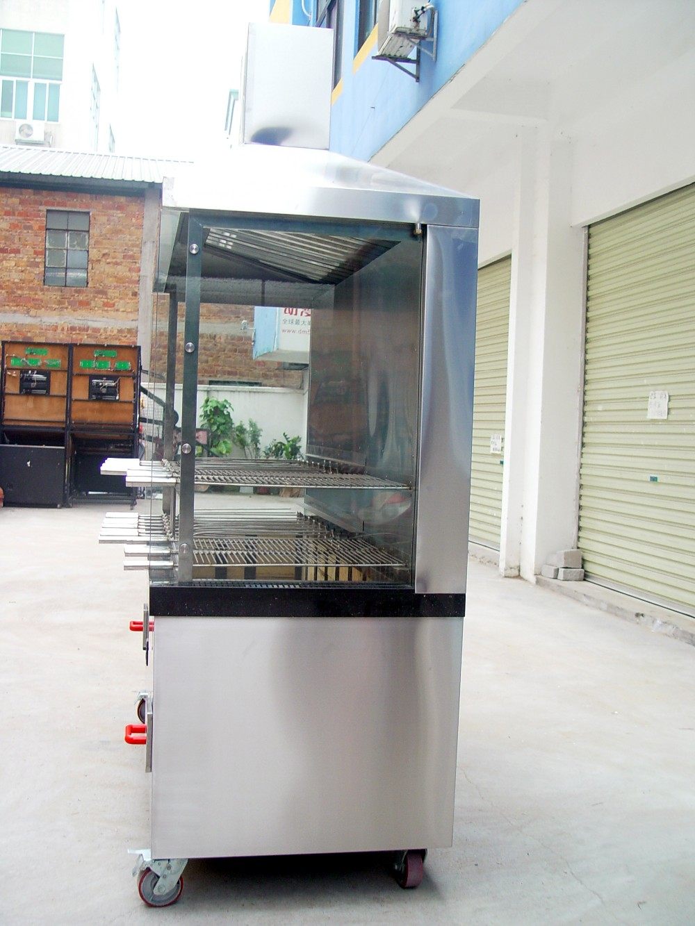 commercial chicken rotisserie with hood