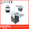 Automatic air suction paper folding machine