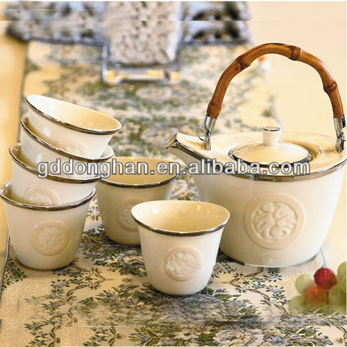 Eco -friendly Chinese style embossed tea set with fiber bamboo handle