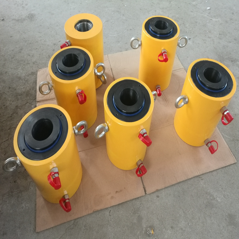 Single acting center hole hydraulic cylinder jack ram