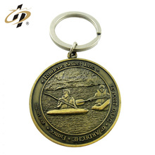 Free sample custom cheap zinc alloy 3d emboss antique round shape sports metal keychain