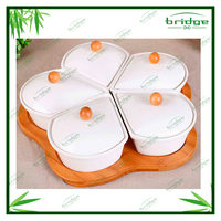 european drop style ceramic spice serie with bamboo tray and the lip of cover