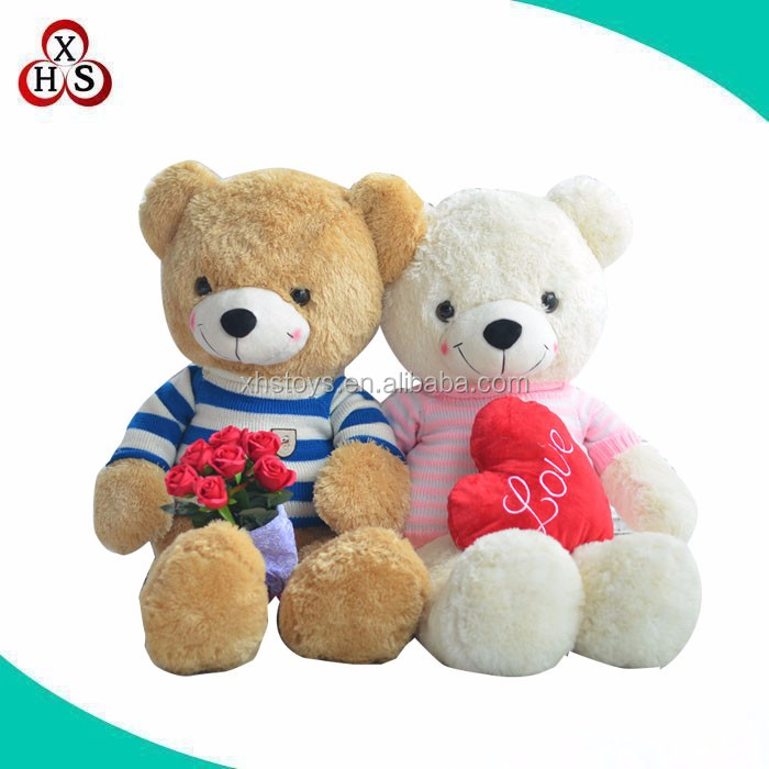 stuffed plush sleeping teddy bear toy with red heart
