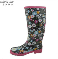Rubber rain boot women fashion boot has black ground with flower printed