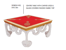 Centre Table With Carved Legs and Glass Covered Padded Fabric Top