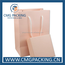 Pink paper gift packing bag with ribbon