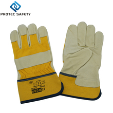 Pig grain leather gloves,yellow cotton drill back,rubberized cuff,half lining winter gloves
