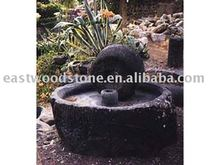 old grinding stone,garden decoration,old stone