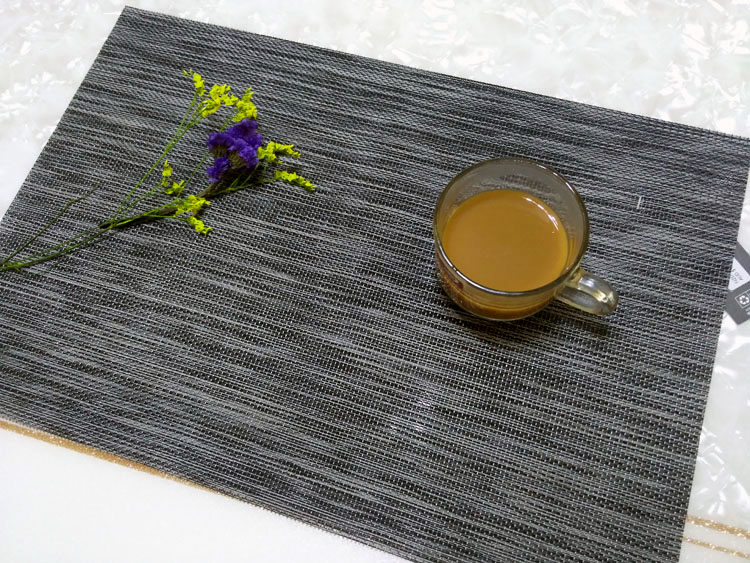 Black heat resistant placemat for dining table