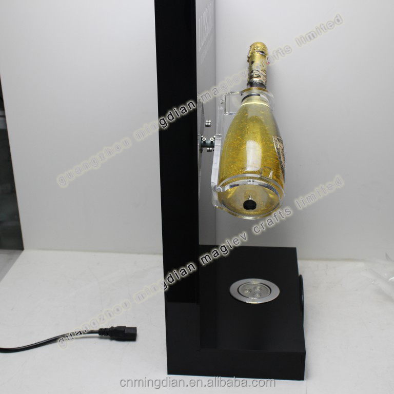 Acrylic LED lighting 360 degree rotating wine bottle display rack , sparkling golden wine stand