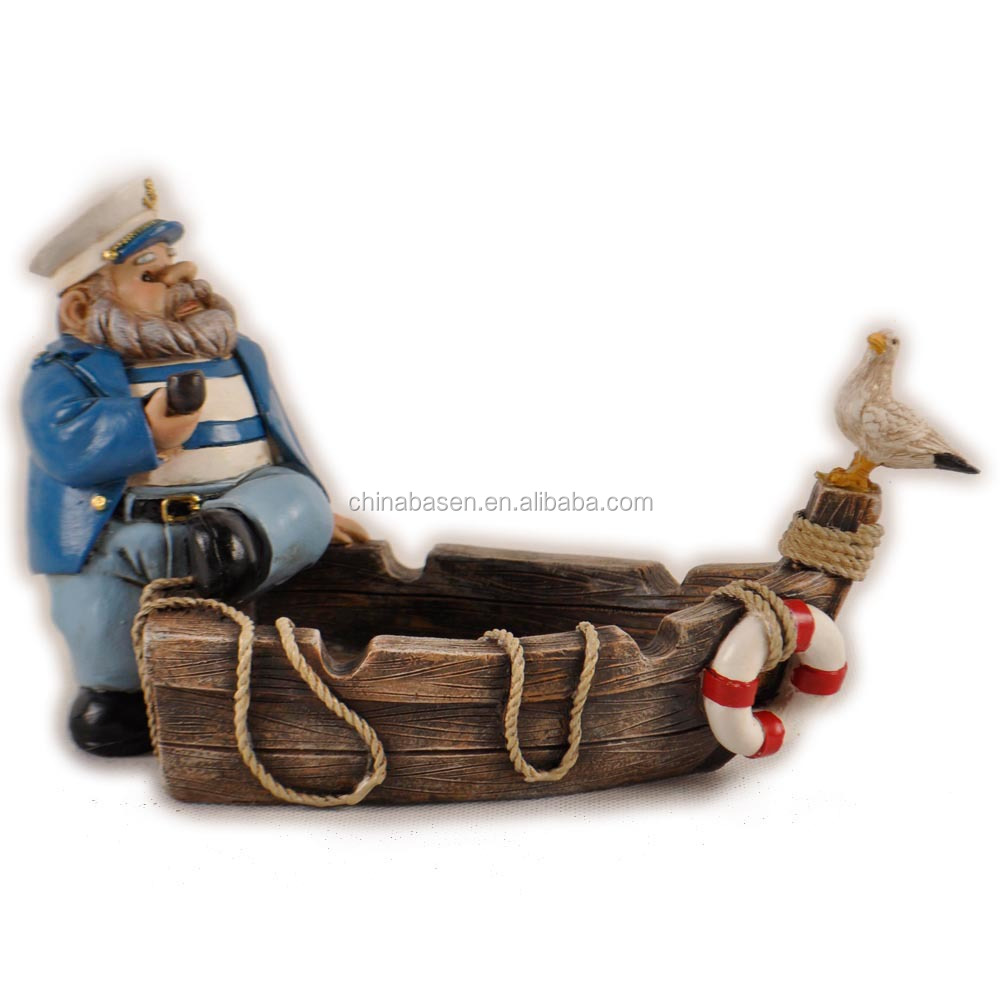 Resin products fat captain sitting on the boat with bird