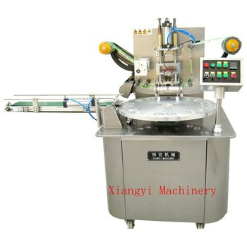Rotary type cup sealing machine