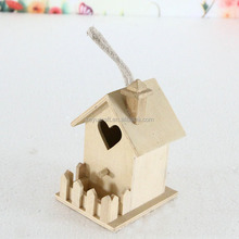 engraved small wooden bird house