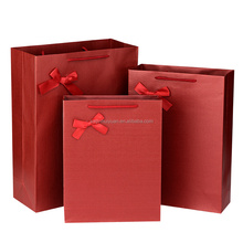 CMYK full color gift paper bag with ribbon bow tie