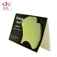 Green leaf shaped sticky notes