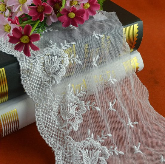 Latest fancy white polyester embroidery net lace with flower design for bridal dress/garment