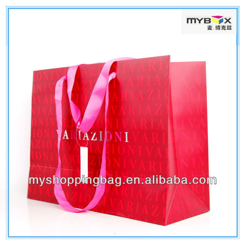 Red art paper bag shopping bag with pink silk ribbon