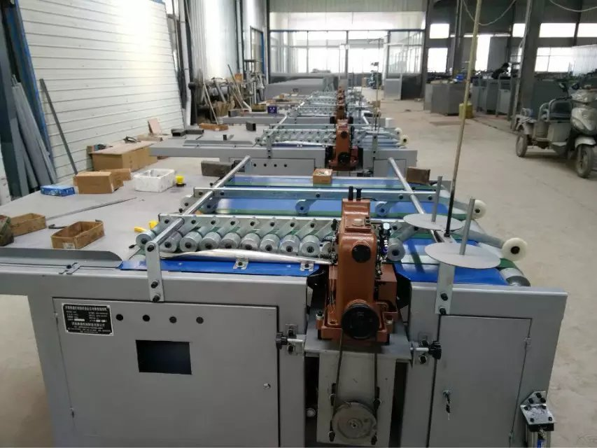 Automatic plastic bag sewing machine making machine