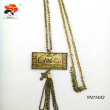 "The cross necklace with words ""with God all things are possible"""