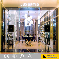 Luxury Glasses Stands Showcase With Golden Stainless Steel Leg For Optical Shop