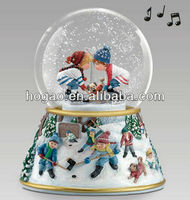 Christmas hockey player snow globe