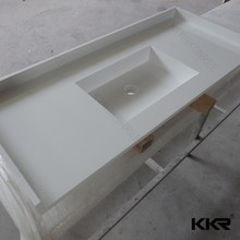 Faux stone material molded sink countertop