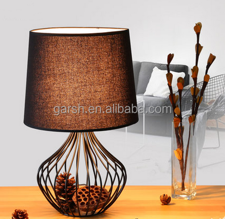 Simple modern bedroom black iron cage fabric table lamp