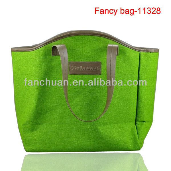 Green leather handles cotton canvas tote bag