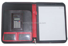 black and red color leather cover portfolio with small calculator