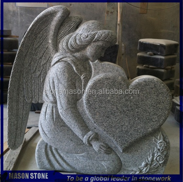 Grave stone angel with heart tombstone
